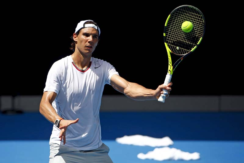 Towels lie on the court as Spain's Rafael Nadal hits a shot during a practice session at Melbourne Park, Australia, January 13, 2016. Photo: Reuters