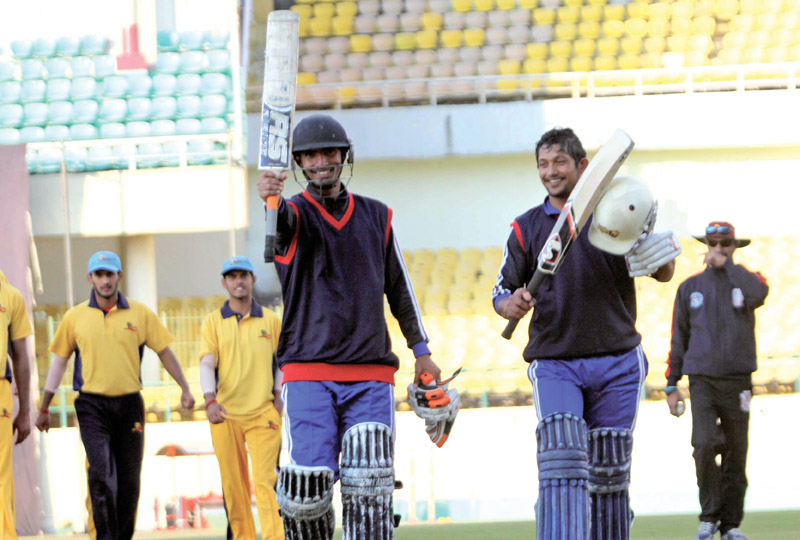 Nepal U-19 skipper Raju Rijal (right) and Sunil Dhamala walk off the field after their practice match against Himachal Pradesh Cricket Association XI at the Dharamshala Cricket Stadium on Friday. Photo: Courtesy CAN