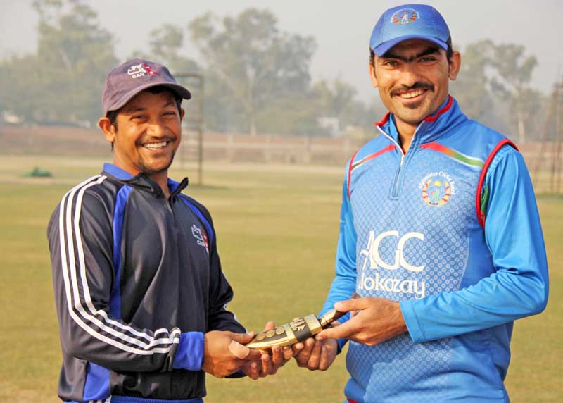 Nepal U-19 skipper Raju Rijal (left) shakes hands with Afghanistan counterpart Ikram Khail before their match at the St Stephen College grounds in New Delhi on Monday. Photo: CAN