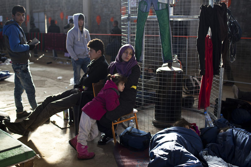 Refugees wait their turn at the Tabakika registration center, Chios island, Greece on Friday, January 15, 2016. Photo: AP