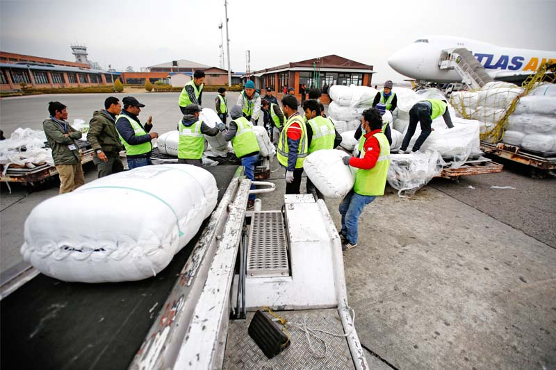 Aid workers loading relief materials brought for earthquake survivors onto trucks in the Tribhuvan International airport, Kathmandu, on Tuesday, January 19, 2016. Photo: THT