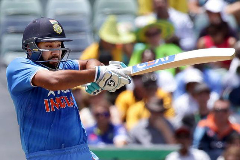 India's Rohit Sharma hits a boundary during their One Day International cricket match against Australia in Perth January 12, 2016. Photo: Reuters