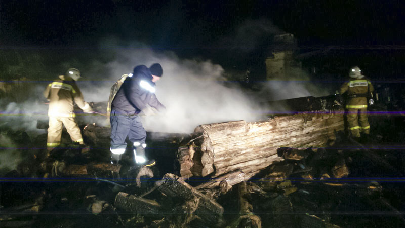 In this Russian Emergency Situations Ministry photo, made available on Saturday, January 9, 2016, firefighters work to extinguish a fire at a wooden the house in the Leningorsk region of Tatarstan, about 950 kilometers (600 miles) east of Moscow, Russia.  Photo: via AP