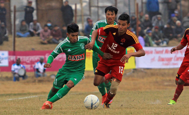 Players of Sahara Football Club of Pokhara (Green) and Nepal Army Club (red), vie for a ball during the semi-final of 14th Aaha-Rara Gold Cup in Pokhara, on Wednesday, January 27, 2016 . Photo: Umesh Pun