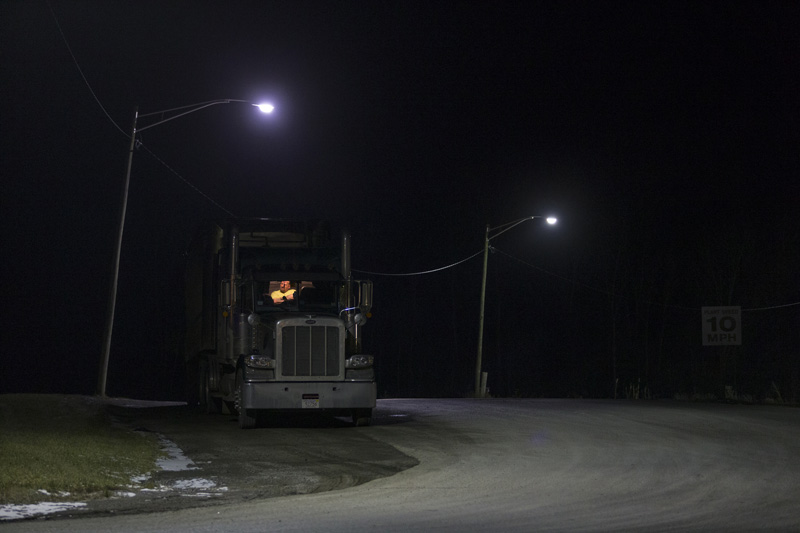 A truck sits at what would normally be a busy truck staging area at the Cargill salt mine, early Thursday, Jan. 7, 2016, in Lansing N.Y. Emergency crews rescued four of 17 miners early Thursday who were stuck for hours in an elevator 900 feet underground at the salt mine that's the deepest in the Western Hemisphere, officials said. (Simon Wheeler/The Ithaca Journal via AP) NO SALES; MANDATORY CREDIT