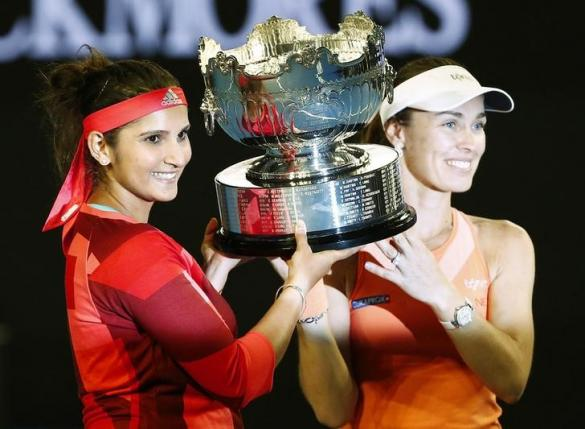 Switzerland's Martina Hingis (R) and India's Sania Mirza pose with the trophy after winning their doubles final match at the Australian Open tennis tournament at Melbourne Park, Australia, January 29, 2016. REUTERS/Thomas Peter