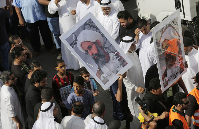 File - Saudis carry a poster demanding freedom for jailed Shiite cleric Sheikh Nimr al-Nimr, during a funeral procession, in Tarut, Saudi Arabiaon Saturday, May 30, 2015. Photo: AP