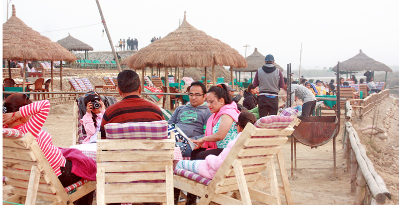 Tourists enjoying at a restaurant along the bank of Rapti River in Sauraha of Chitwan district on Thursday, January 7, 2016. Photo: RSS