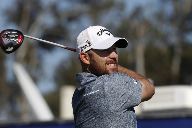Scott Brown tees off on the ninth hole during the first round of the Farmers Insurance Open in San Diego on Thursday. Photo: AP