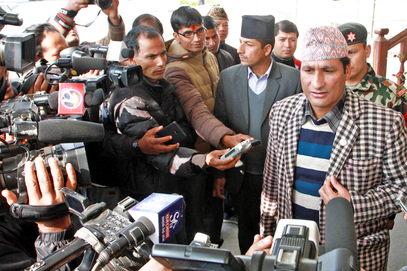 Minister for Home Affairs Shakti Bahadur Basnet speaking with journalists after participating in a National Security Council meeting in Singha Durbar on Sunday, January 10, 2016. Photo: RSS