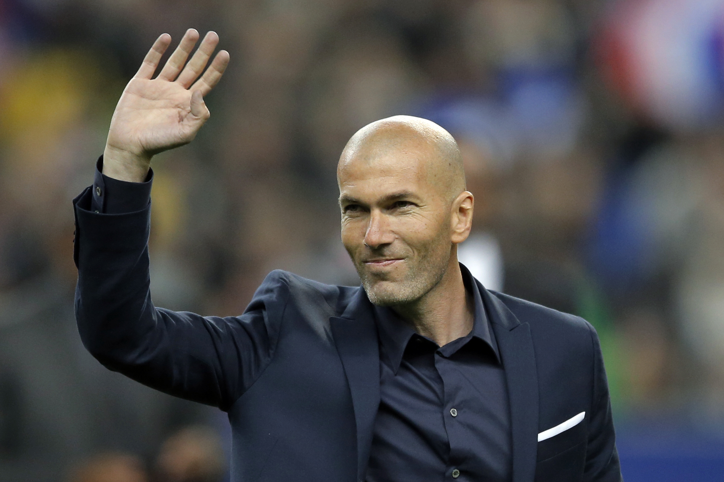 FILE - In this March 26, 2015 file photo, former soccer player and current Real Madrid B team coach Zinedine Zidane waves to spectators prior to the international friendly soccer match between France and Brazil at the Stade de France, north of Paris, France. Photo: AP