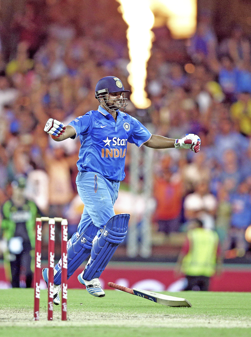 Indiau0092s Suresh Raina celebrates after defeating Australia in their T20 International match in Sydney on Sunday, January 31, 2016. Photo: Reuters