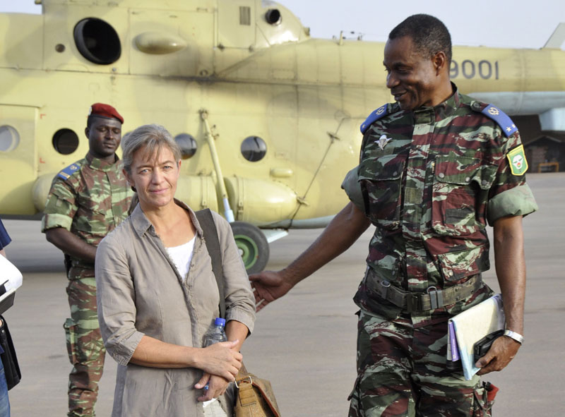 FILE- Released Swiss hostage Beatrice Stockly (left) arrives by helicopter from Timbuktu, Mali after being handed over by a militant Islamic group Ansar Dine, in Ouagadougou, Burkina Faso on Tuesday, April 24, 2012. Photo: AP Photo