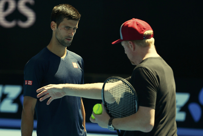 Serbia's Novak Djokovic listens to his coach Boris Becker during a practice session at Melbourne Park, Australia, January 16, 2016. Photo: Reuters