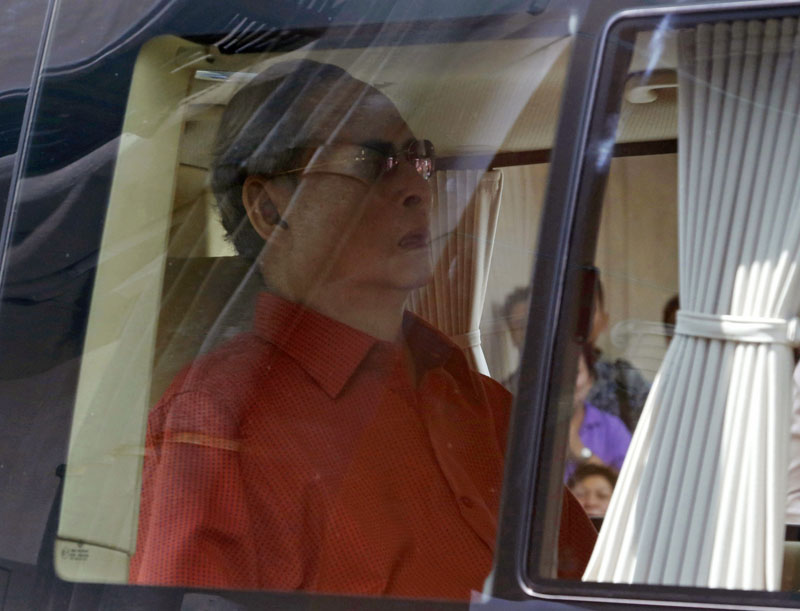 FILE - Thai King Bhumibol Adulyadej, sitting in a car, leaves Siriraj Hospital in Bangkok to return to his seaside palace after his gallbladder being removed during his stay at the hospital since October, 2014, photo taken on May 10, 2015. Photo: AP