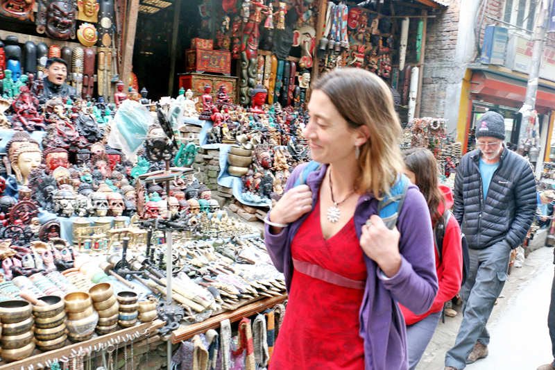 A tourist gives a smiling look at curioes in Thamel of Kathmandu on Friday, January 1, 2015. Photo: RSS