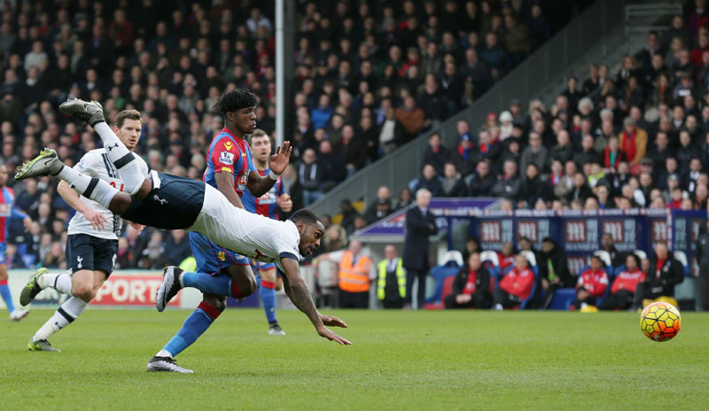 Tottenham Hotspuru2019s Danny Rose goes flying in the air as he defends against Crystal Palaceu2019s Wilfried Zaha during the English Premier League soccer match between Crystal Palace and Tottenham Hotspur at Selhurst Park in London, on Saturday January 23, 2016. Photo: AP