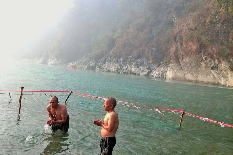 FILE - Devotees taking holy dip in Devghat, the confluence of Trishuli and Kaligandaki rivers in Tanahun on Friday, January 15, 2016. Photo: THT