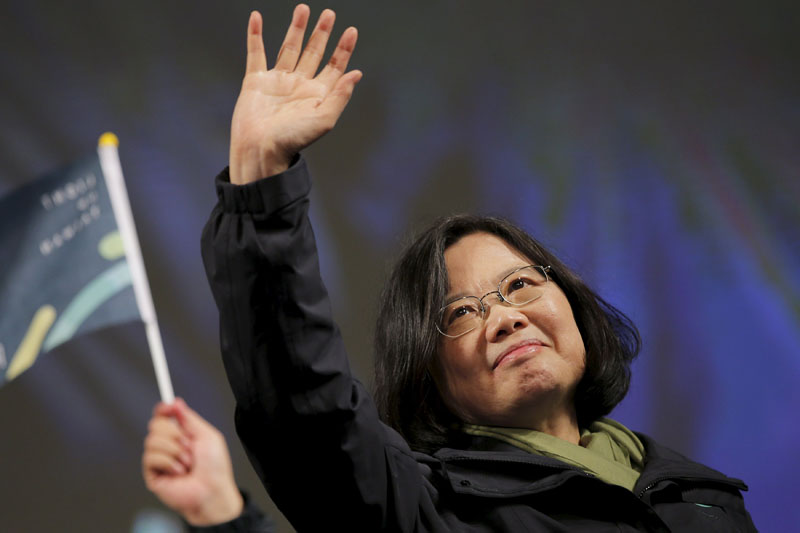 Democratic Progressive Party (DPP) Chairperson and presidential candidate Tsai Ing-wen waves to supporters as they celebrate her election victory at the party's headquarters in Taipei, Taiwan, on January 16, 2016. Photo: Reuters