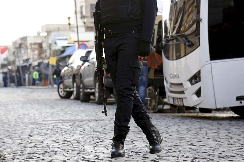 A Turkish police officer patrols in Sur district, which is partially under curfew, in the Kurdish-dominated southeastern city of Diyarbakir, Turkey on January 12, 2016. Photo: Reuters