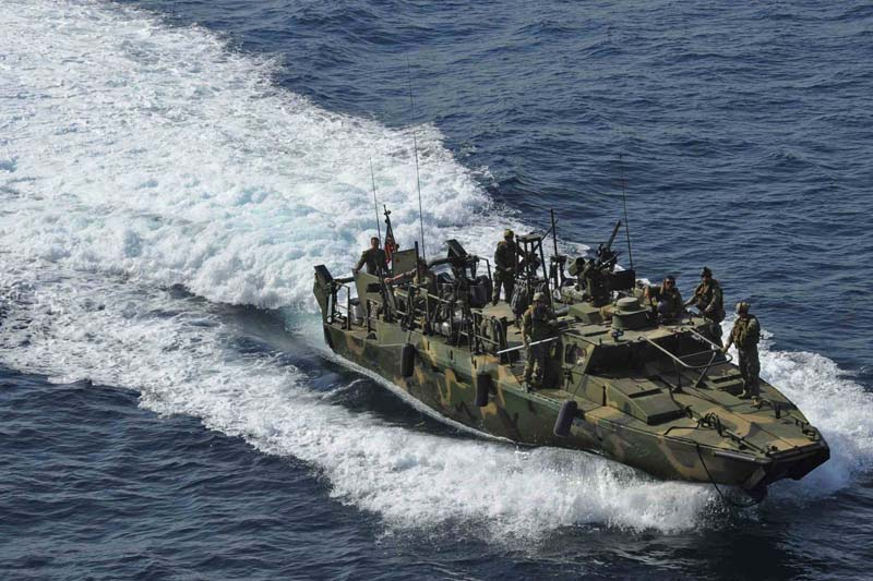 A riverine command boat from Riverine Detachment 23 operates during a maritime air support operations center exercise in the Arabia Gulf in this June 12, 2012 handout photo, provided by the US Navy. Photo: US Navy via Reuters