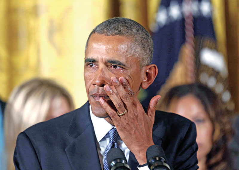 US President Barack Obama wipes away tears while talking about Newtown and other mass shootings during an event held to announce new gun control measures, at the White House in Washington, on Tuesday. Photo: Reuters