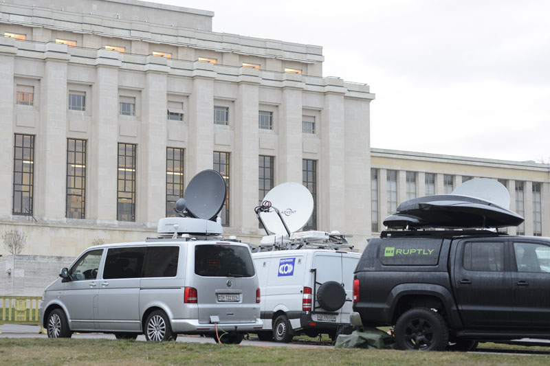 Satellite trucks sit in front the United Nations building before the planned beginning of negotiations between the Syrian government and the opposition in Geneva, Switzerland, on Friday, January  29, 2016. Photo: Martial Trezzini/Keystone via AP
