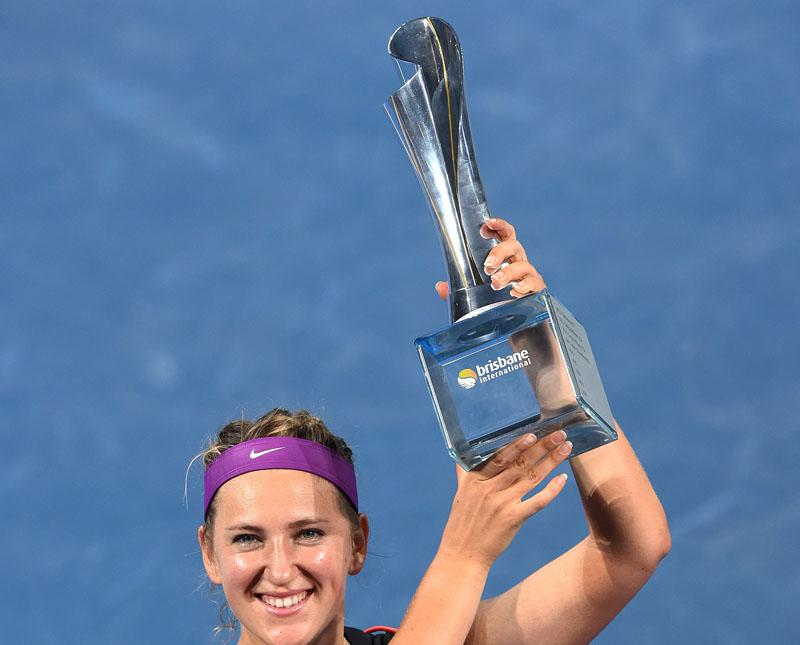 Victoria Azarenka of Belarus celebrates with the trophy after winning the Brisbane International Tennis Tournament on Saturday. Photo: Reuters
