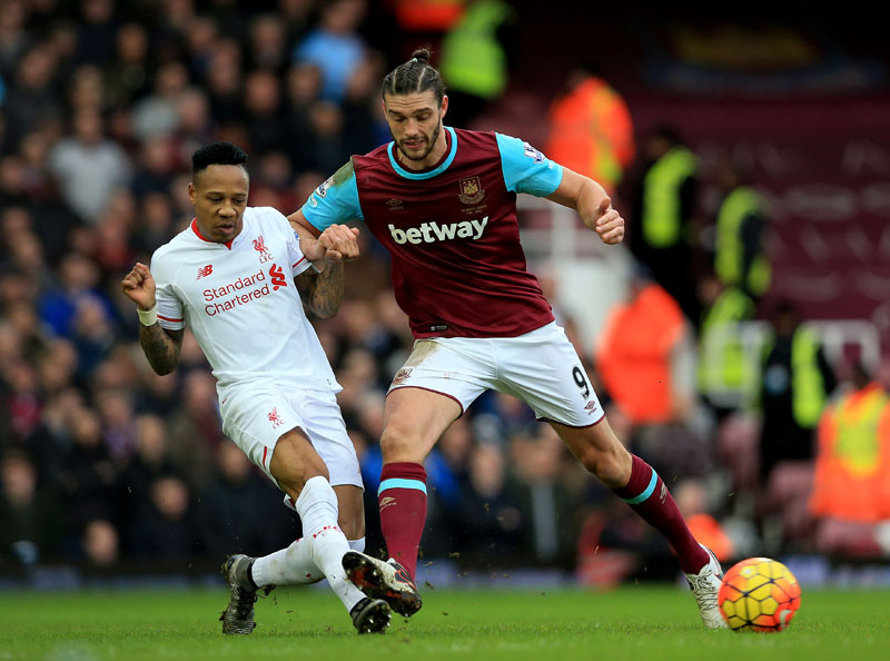 Liverpool's Nathaniel Clyne (left) and West Ham United's Andy Carroll battle for the ball during the English Premier League soccer match against West Ham United at Upton Park, London on Saturday January 2, 2016. Photo: AP