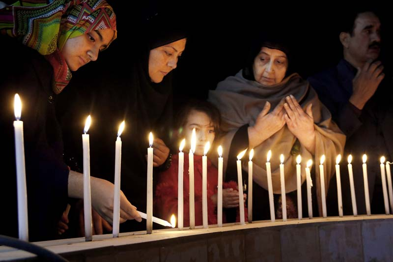 Pakistani women light candles during a vigil for victims of the Bacha Khan University attack, on Wednesday, January 20, 2016 in Peshawar, Pakistan. Photo: AP