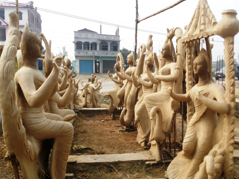 Wooden statues of Saraswati, the Goddess of Wisdom and Knowledge, are being prepared in the run-up to the upcoming Shreepanchami festival, in Gaur, the district headquarters of Rautahat district, on Sunday, January 31, 2016. Photo: Prabhat Kumar Jha