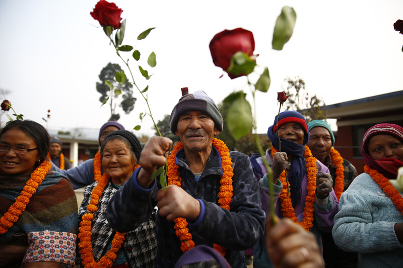 People affected by leprosy hold roses as they take part in an awareness program to celebrate World Leprosy Day in Khokana of Lalitpur on Sunday, January 31, 2016. Photo: Skanda Gautam