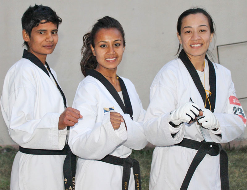 (From left) Yan Kumari Chaulagain, Rejina Karki and Ayesha Shakya pose after a selection tournament in Lalitpur on Monday. Photo: THT