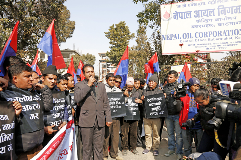 Cadres affilated with Youth Association Nepal protest against black-marketing and irregularites in petroleum product, infront of Nepal Oil Corporation in Babarmahal on Wednesday, January 6, 2016. Photo: RSS