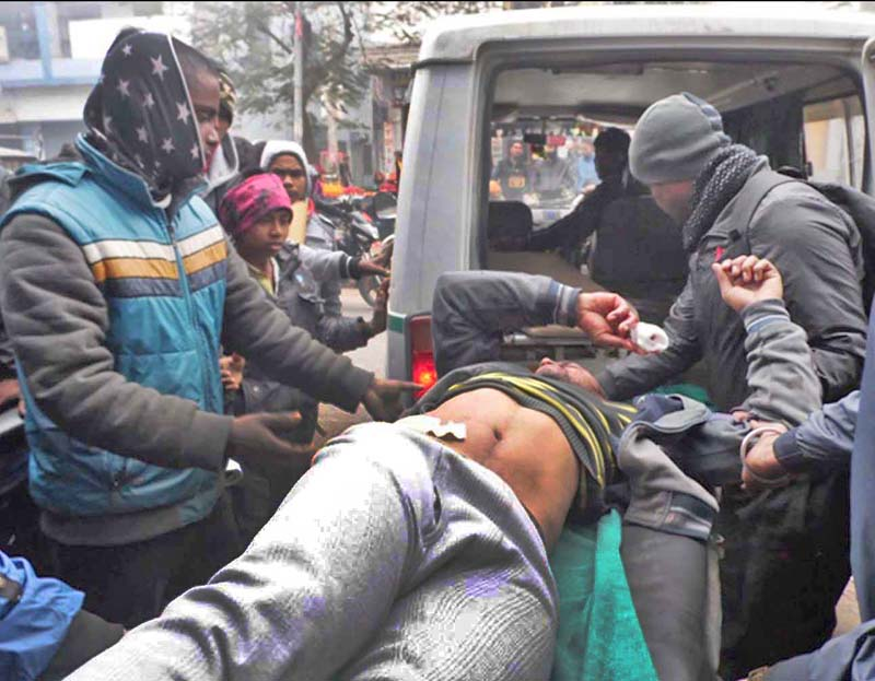 An injured man being taken into a vehicle after he was attacked with a sharp weapon at Adarshanagar, Birgunj, on Sunday.  Photo: THT