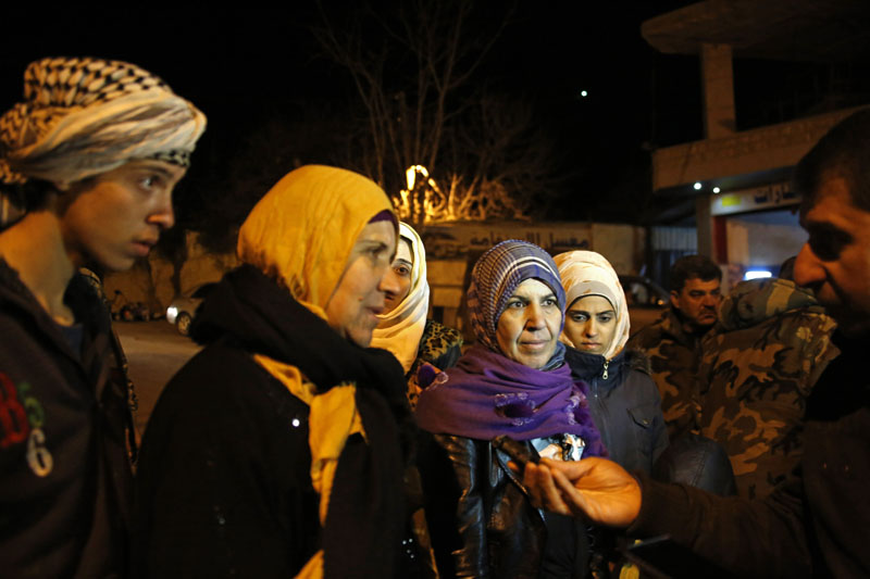 Residents talk to a reporter after the arrival of an aid convoy, in the besieged town of Madaya, northwest of Damascus, Syria, on Monday, January 11, 2016. Photo: AP