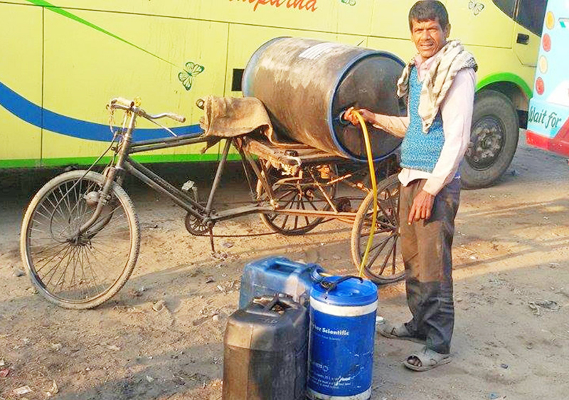 A local businessman pouring diesel that was bought in the black-market intojerry cans in Chandranigahapur,  Rautahat, on Tuesday, January 5, 2016. Photo: THT
