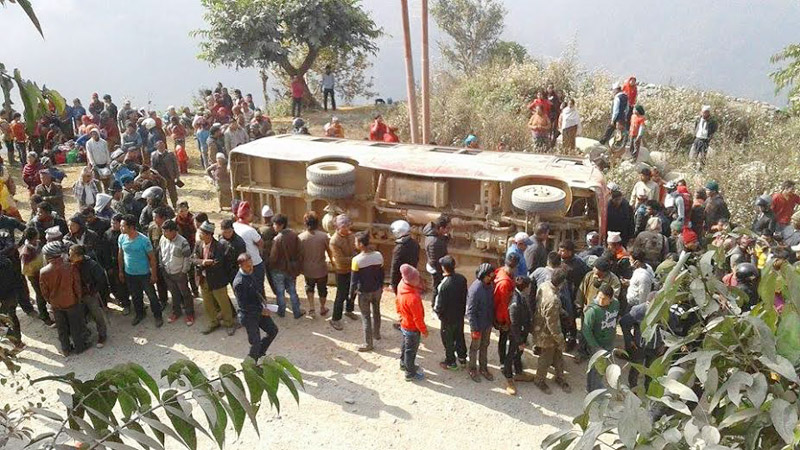 People gather at Michhurlung of Majhkot VDC in Tanahun district after a bus accident on Monday, January 18, 2016. Photo: Madan Wagle