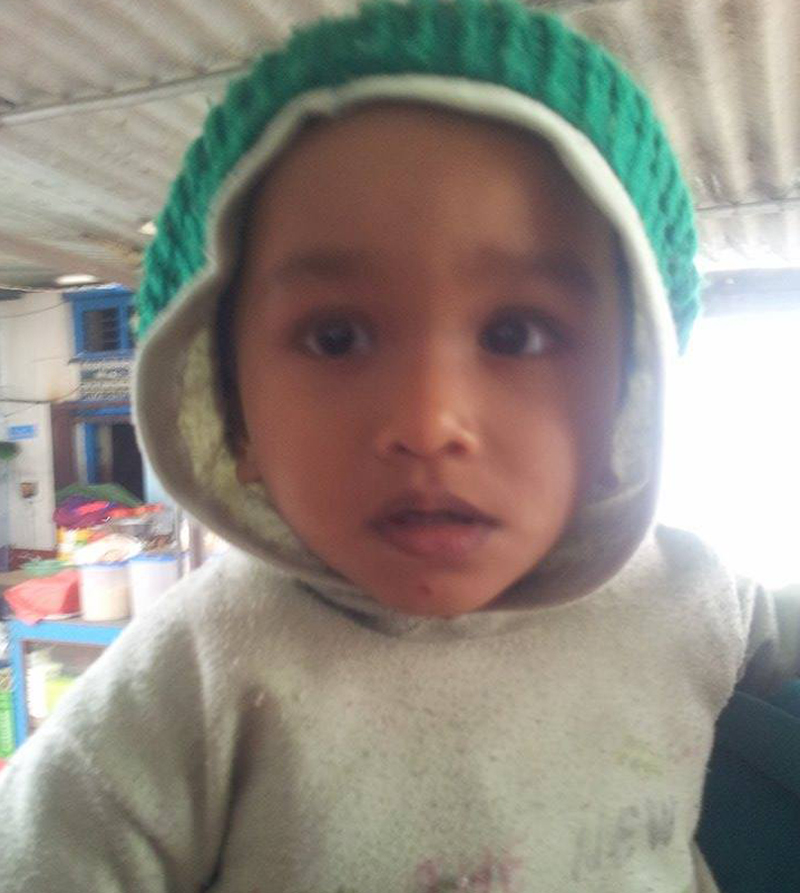 The 1.5-year-old Suraj Paswan is forced to live behind bars after both of his parents were jailed, in Pokhara of Kaski, on Wednesday, January 13, 2016. Photo: Bharat Koirala