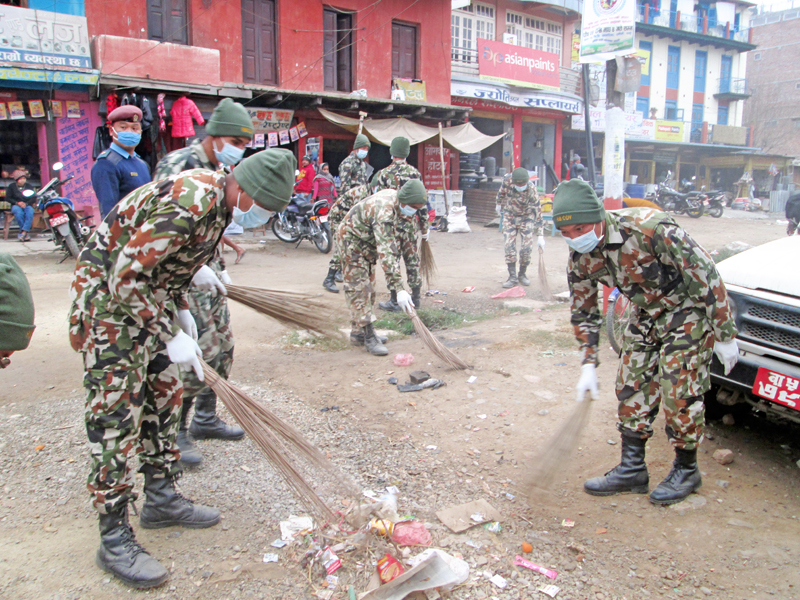 Nepal Army personnel cleaning Damauli Bazaar for the upcoming Damauli Festival slated to be held in Damauli in Tanahun district from January 8 to 18, on wednesday, January 6, 2016. Photo: Madan Wagle
