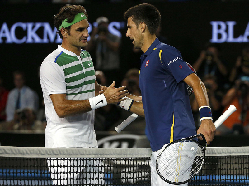 Serbia's Novak Djokovic (R) and Switzerland's Roger Federer shake hands after Djokovic won their semi-final match at the Australian Open tennis tournament at Melbourne Park, Australia, January 28, 2016. REUTERS/Tyrone Siu