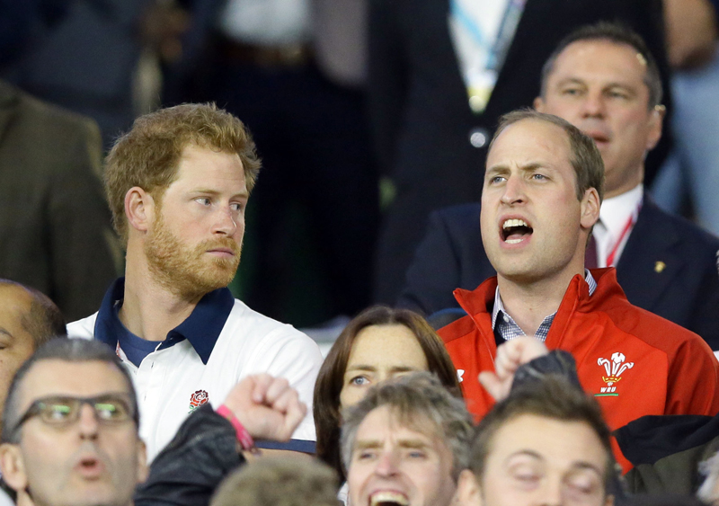 FILE - This is a Saturday, September 26, 2015  file photo of Britainu0092s Prince William, right, sings the national anthem of Wales as Prince Harry looks on ahead of the Rugby World Cup Pool A match between England and Wales at Twickenham Stadium, London.