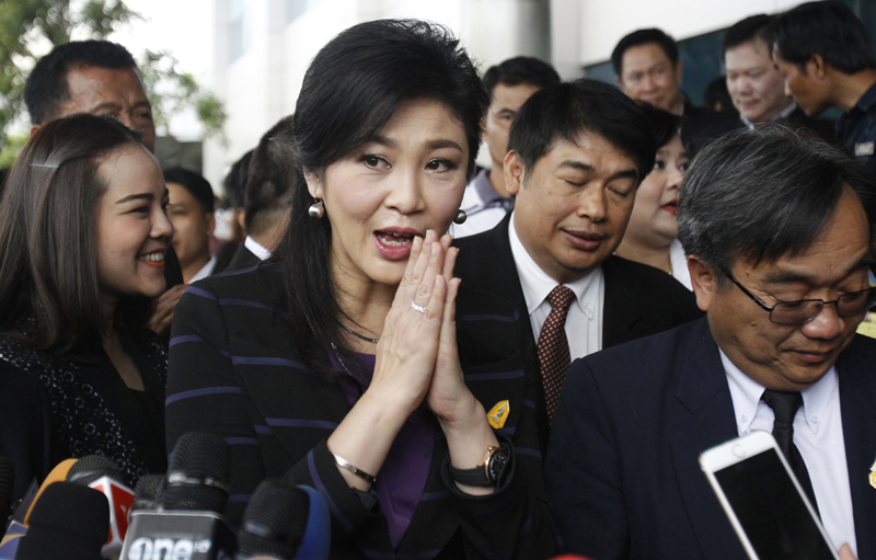 Thailand's former Prime Minister Yingluck Shinawatra greets reporters while talking to the media upon arrival at the Supreme Court, Bangkok Thailand, Friday, Jan. 15, 2016. Yingluck is being tried on charges that while prime minister she mismanaged a rice subsidy program for the countryu0092s farmers, costing the government billions of dollars. The first witnesses testified Friday.  Photo: AP