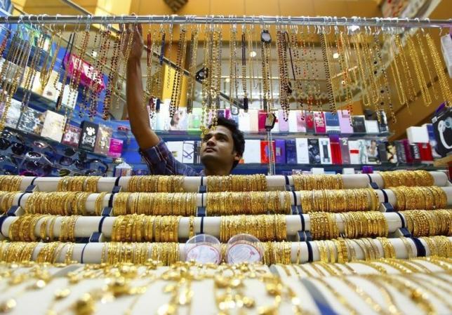 A salesman arranges jewellery at a shop at the gold souk in Deira, April 17, 2013. REUTERS/Jumana El Heloueh