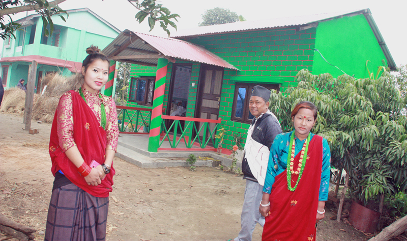 Locals dressed in traditional costume welcomes tourists in their newly lauched home stay service at Shivadwar in Madi of Chitwan district on Wednesday, January 27, 2016. Photo: RSS