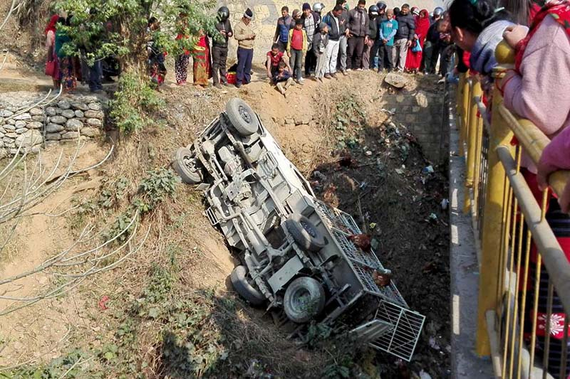 People looking over a site of the jeep accident where it fell some 20 metres off the road near a bridge over Madi River, of Byas Municipality-10, Tanahun, on Tuesday, January 26, 2016. Photo: Madan Wagle/ THT