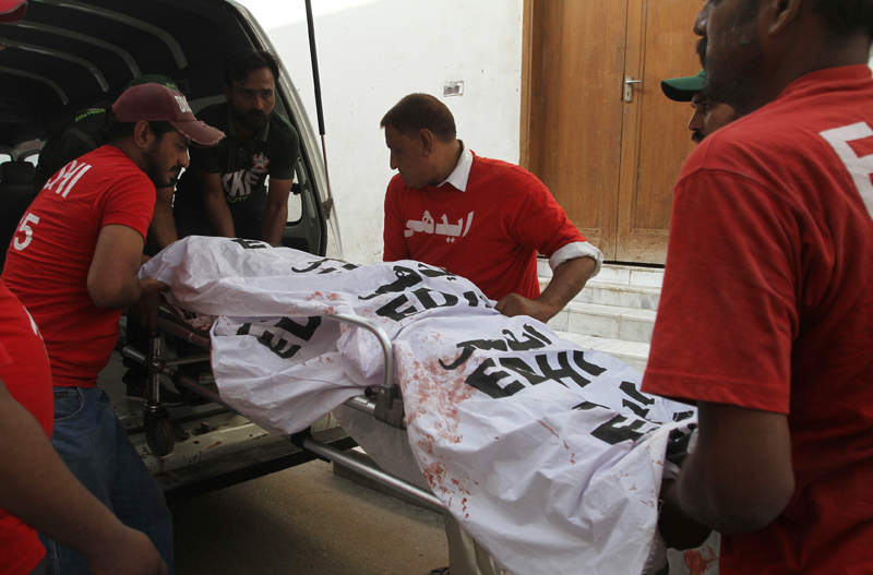 FILE - In this Wednesday, September 9, 2015 file photo,volunteers load the dead body of  Pakistani journalist, Aftab Alam, who was killed by unknown gunmen, into an ambulance at a local hospital in Karachi, Pakistan. Photo: AP