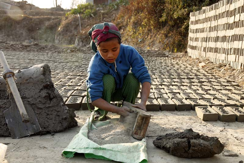 A child labourer making bricks at the Bhaktapur Brick Industry, in Bhaktapur on January 6, 2016. Photo: RSS