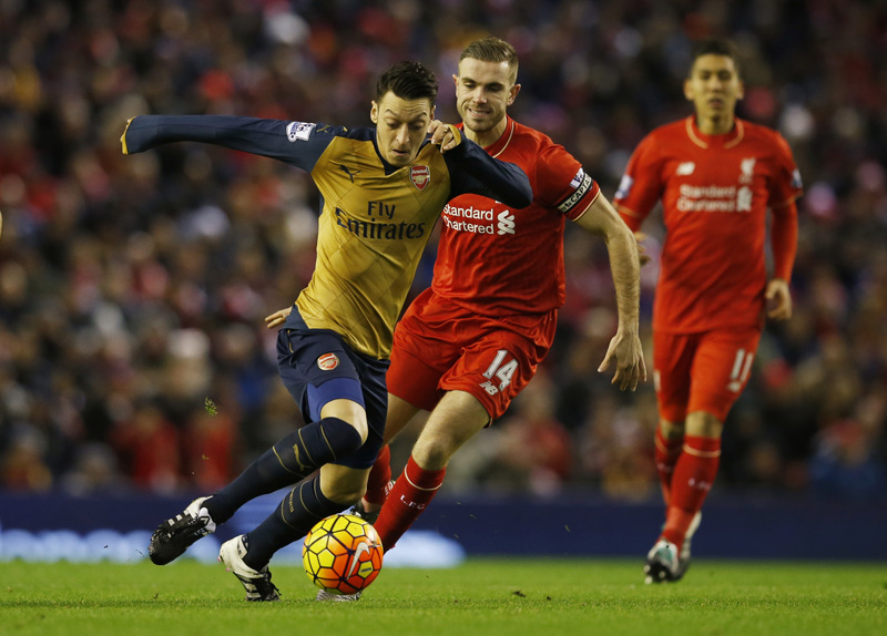 Liverpool's Jordan Henderson in action with Arsenal's Mesut Ozil during Barclays Premier League at Anfield in January 13, 2016. Photo: Reuters