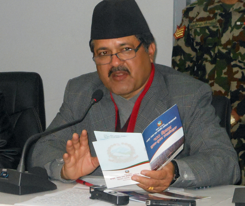 Minister for Law, Justice and Parliamentary Affairs, Agni Prasad Kharel, speaks at a press conference in Kathmandu, on Sunday, January 31, 2016. Photo: RSS